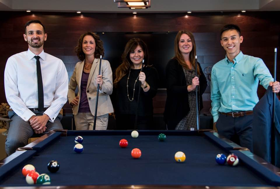 Young professionals at billiard table